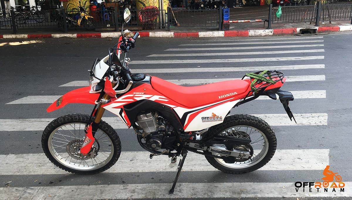 Honda CRF150L Dual Enduro Hire - Hanoi Motorbike Rental. Red and White, front and back disc brakes.