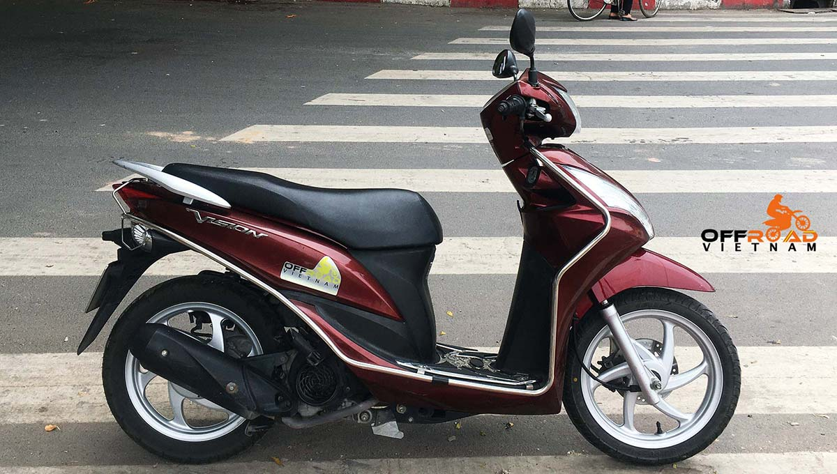 Hanoi Scooter Rental - Honda Vision 110cc For Rent in Hanoi, 2014 red color with stainless steel protection frame.