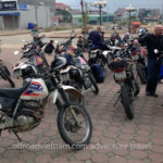 Large group on a Vietnam motorbike tour gets ready for a riding day